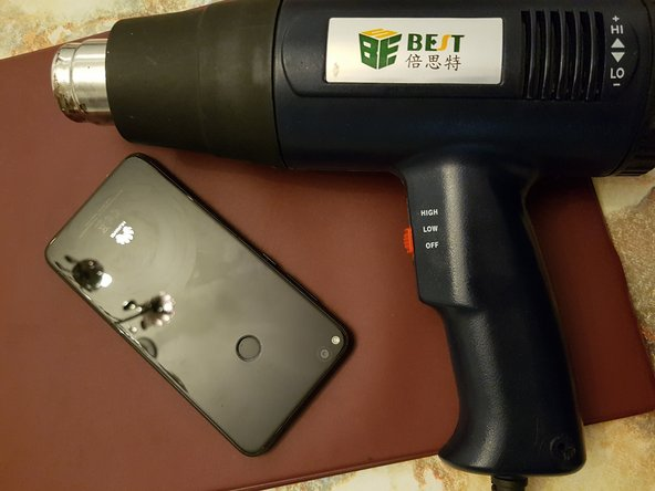 Heat the backglass with a heat gun.