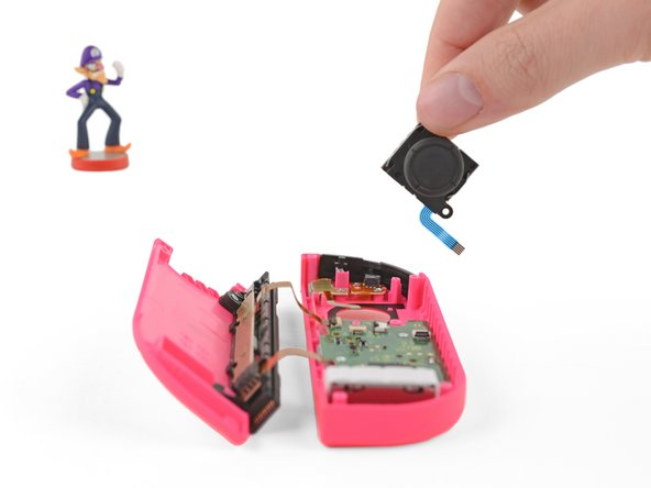 Carefully remove the joystick from its housing.