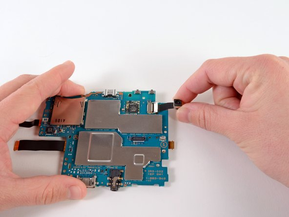 Gently pull the rear camera out of the flex cable socket.