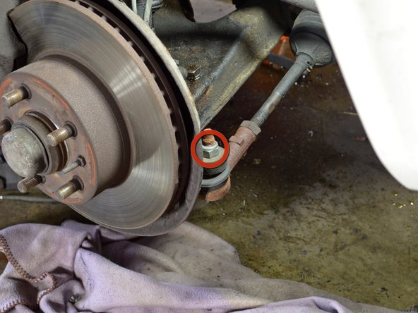 Use a socket wrench or impact gun to remove the 19 mm tie rod end nut.