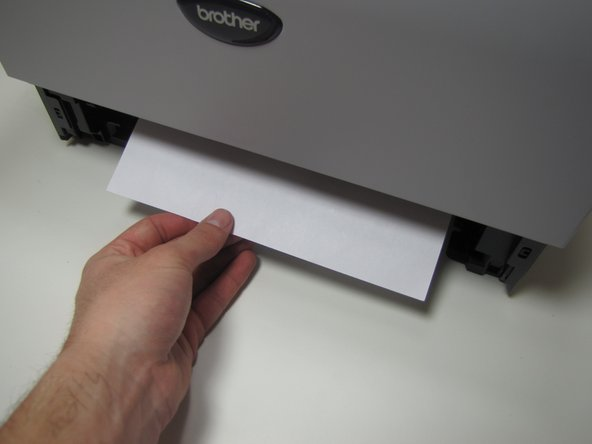 If jammed paper is visible, grab onto the paper and remove by pulling up and towards yourself.