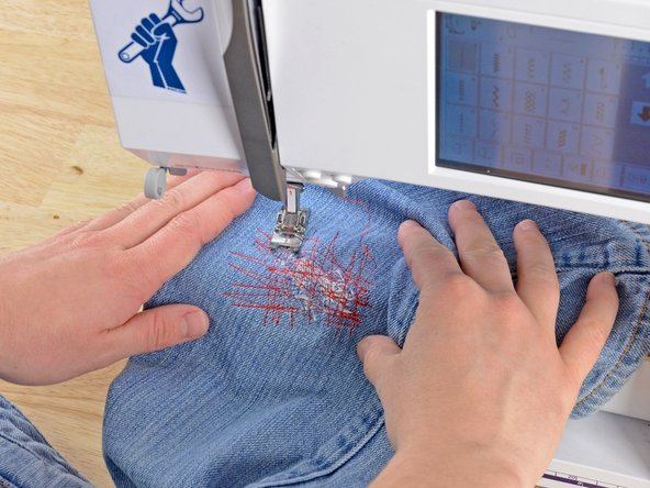 Just like before, at the end of each line of stitching, lift the pressor foot, rotate the jeans a few degrees, and sew another line of stitching.