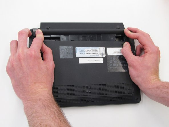 Once the switches have both been unlocked, push the battery upwards away from the rest of the laptop.