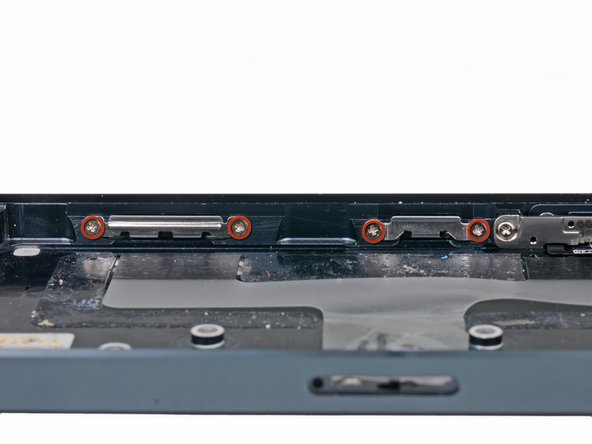 The four front panel clips are held in with two 1.3 mm Phillips screws each. Remove the screws on the clip(s) you want to replace.