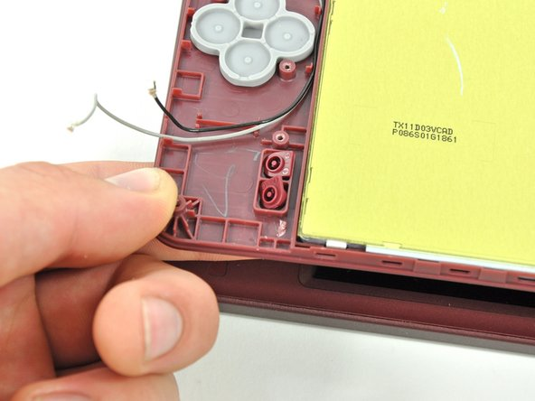 Open the display slightly and push the start and select buttons up through the upper case.
