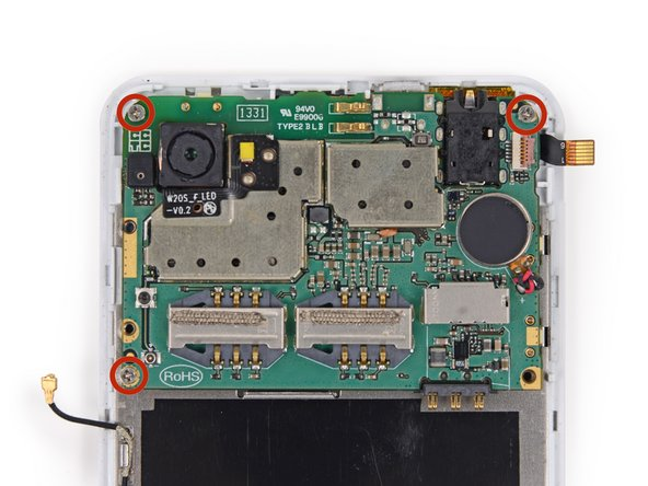 Remove the three 2.5 mm Phillips #000 screws securing the motherboard to the display assembly.