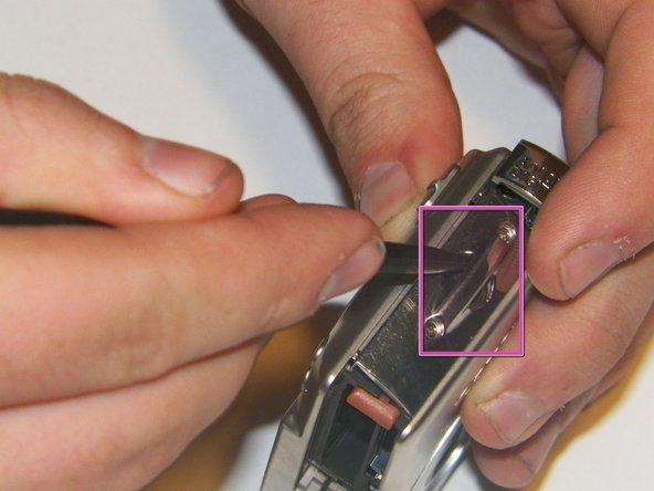 Remove the wrist strap attachment.