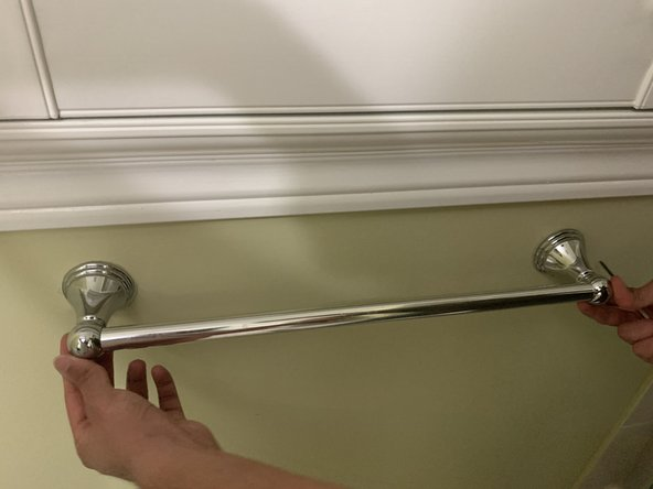 Place the new towel bar on top of the wall brackets and make sure that the bar is level.
