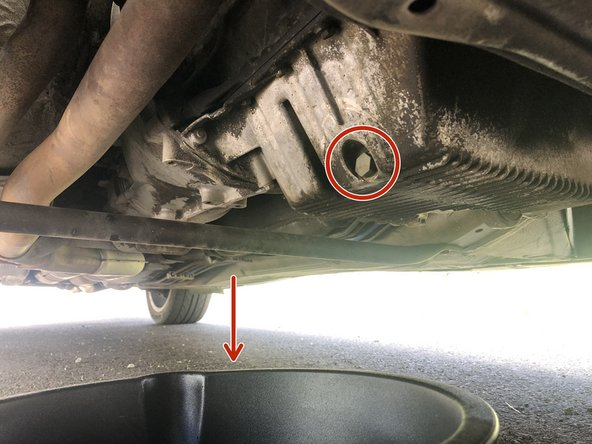 Place the oil pan underneath the plug