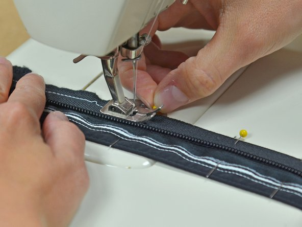 While you're sewing, remove the pins as you come to them. Running them over with your machine may break your needle.