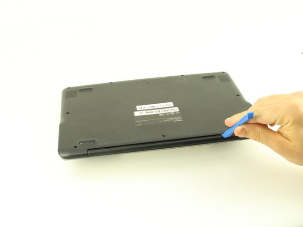 Use a iFixit opening tool to gently pry the case up from the vent on the hinge side of the Chromebook.