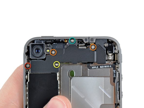 Remove the following five screws securing the connector cover to the iPhone: