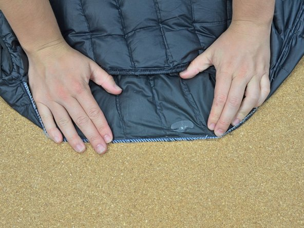 Align the folded edge of the scrap along the outermost seam on the baffle you want to replace.