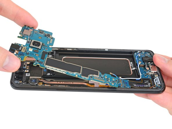 We pop out the action-packed motherboard and start plucking off cameras.