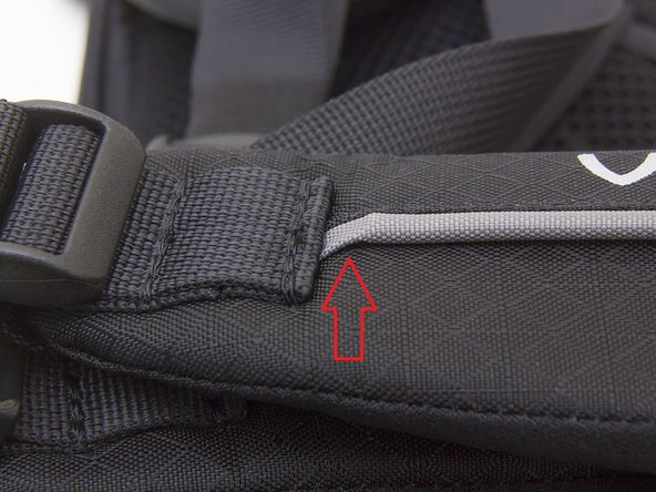 Guide the new sternum strap onto the thin end of the rail.