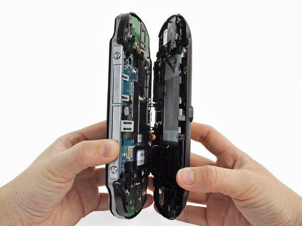 Gently separate the two cases, minding the battery and the touch screen controller connectors holding the two cases together.