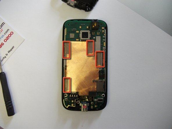 Remove the RF shield by carefully peeling off the 4 pieces of metallic tape.