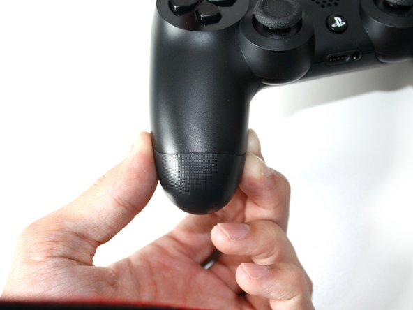 Remove the bottom half of the controller while monitoring the triggers and springs within.