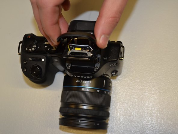 After closing the flash head, pull the black flash head cover up and off of the flash head.