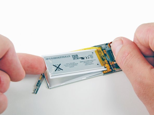 Use your fingers to carefully lift the battery off the back of the LCD, starting at the top of the LCD.