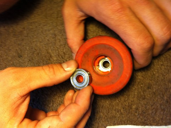 Push the bearing into the wheel by applying even pressure with your thumb.