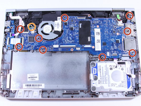 Remove the system board (motherboard).