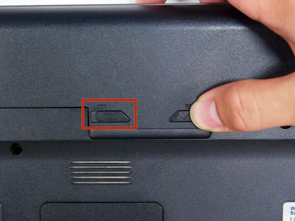 Locate two switches above the battery that lock it into place.