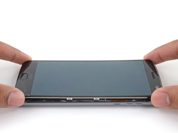 Lift the screen assembly from the right edge and swing it open. It is still attached to the phone chassis at the lower left edge, so do not fully remove it yet.