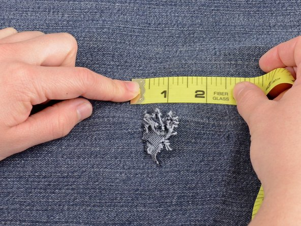 Measure the length and width of the hole in your jeans, including any damaged area around the hole.