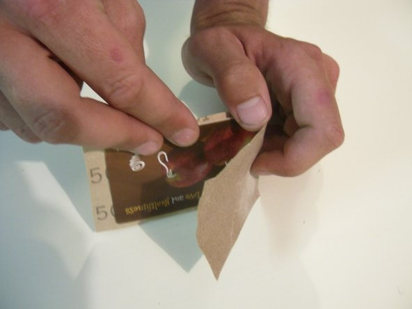 Fold fine grit sand paper over a credit card.