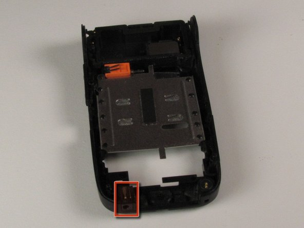 Locate the small speaker module on the back of the separated battery compartment in the lower left hand corner.