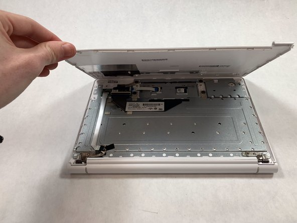 Fully take off the back panel by lifting up the panel.