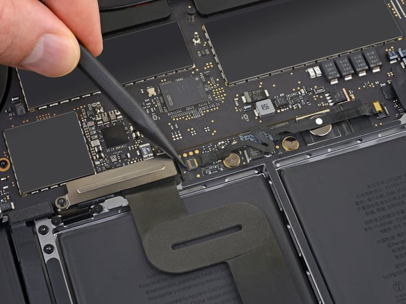 Pry up and disconnect the locking flap on the connector at the opposite end of the battery board data cable.