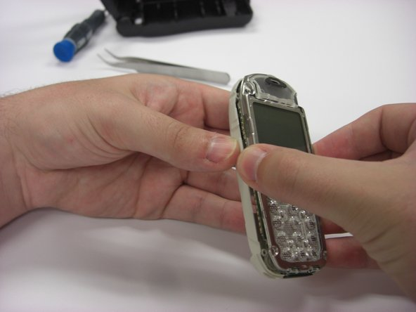 To remove the back plastic cover, grasp the device with both hands as seen in the first picture.