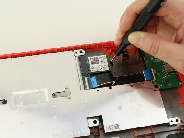 Remove the one 3.6mm Phillips #0 screw from the WiFi card.