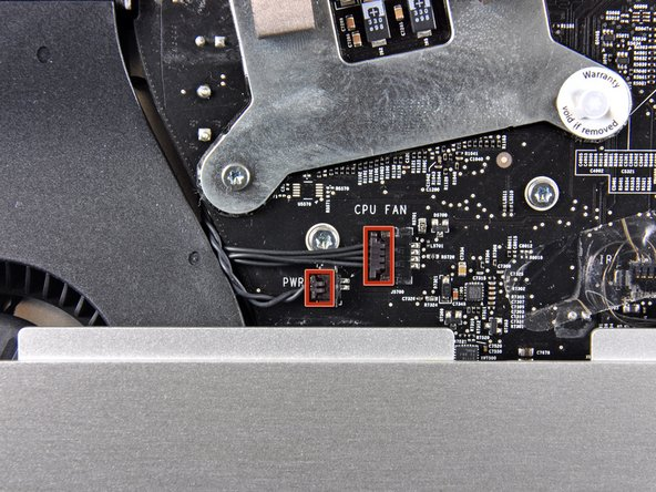 Disconnect the CPU fan and power button by pulling their connectors toward the left edge of the iMac.