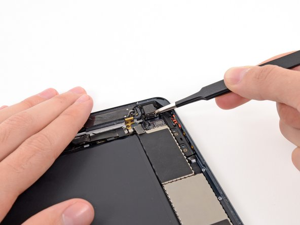 Remove the rear-facing camera from the iPad.