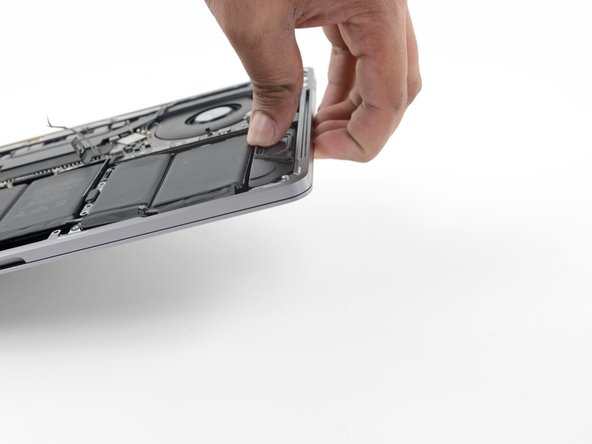 To control the flow of adhesive remover and direct it away from the speaker, raise the right edge  of your MacBook Pro a few inches using a book or foam block.