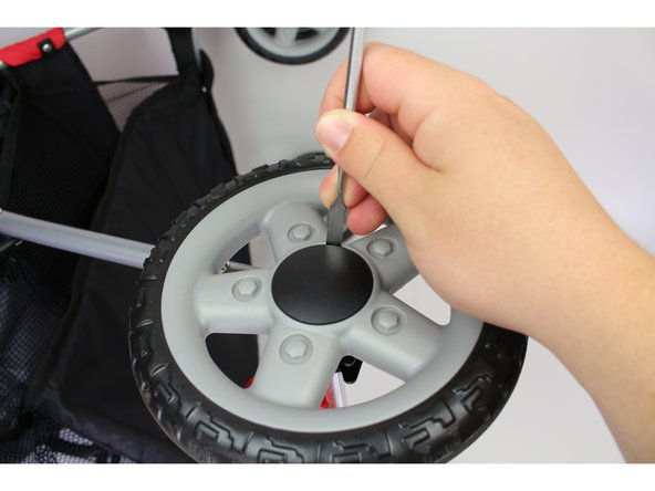 Applying too much force to the spudger can cause the spudger to bend or the hubcap to break. To avoid this, try prying the hubcap from a different angle or positioning your spudger at a different points around the hubcap.