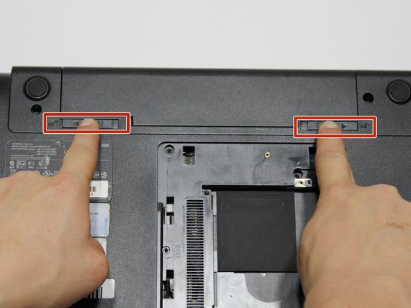 Remove the battery by pushing out the locks on either end then pushing the battery away from you.