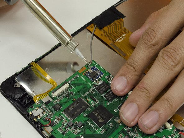 Prepare your Desoldering Tools. Remove the grey wire attached to the Motherboard.