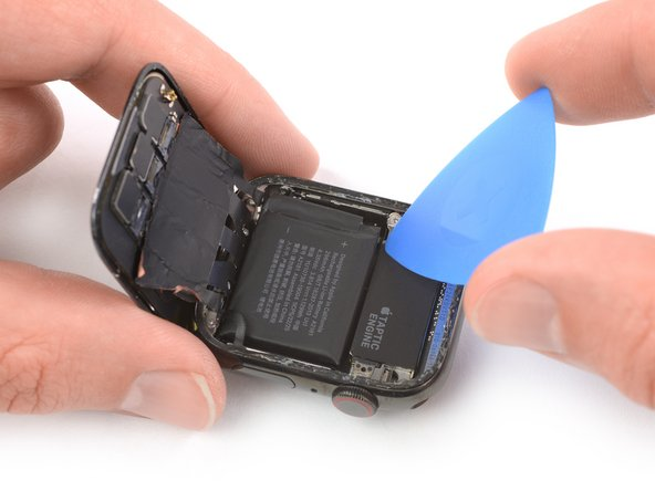 Lift the screen until there's enough space to access the battery.