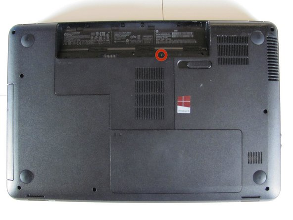 Locate the RAM compartment cover below the battery compartment.