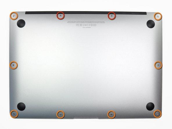 Avant de commencer, fermez votre ordinateur et posez-le à l'envers sur une surface douce.