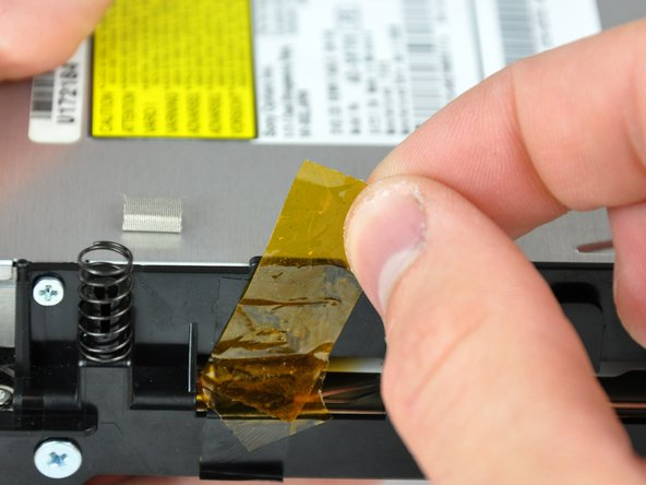 If necessary, remove the yellow kapton tape covering the internal frame and the optical drive.
