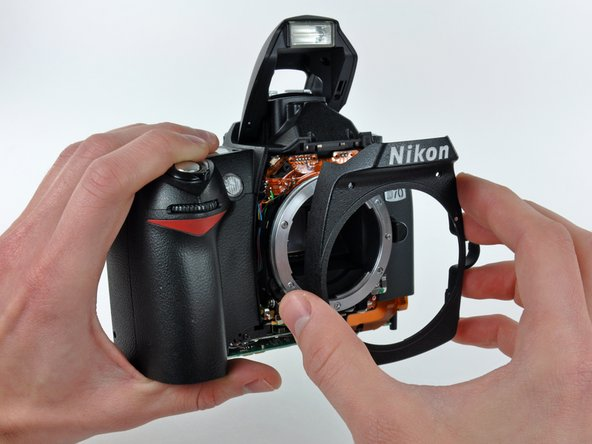 Pull the front cover away from the D70.