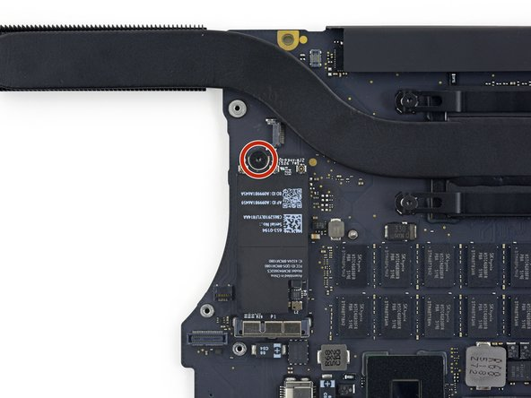 Remove the single 2.9 mm T5 Torx screw securing the AirPort board to the logic board.