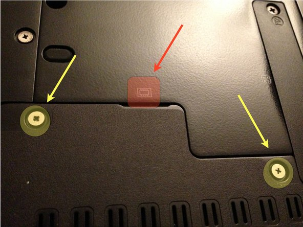 Using the small Phillips head screwdriver, remove the two screws highlighted in yellow.