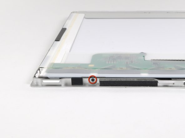 Remove the two 3.2 mm Phillips screws on the top edge of the display.