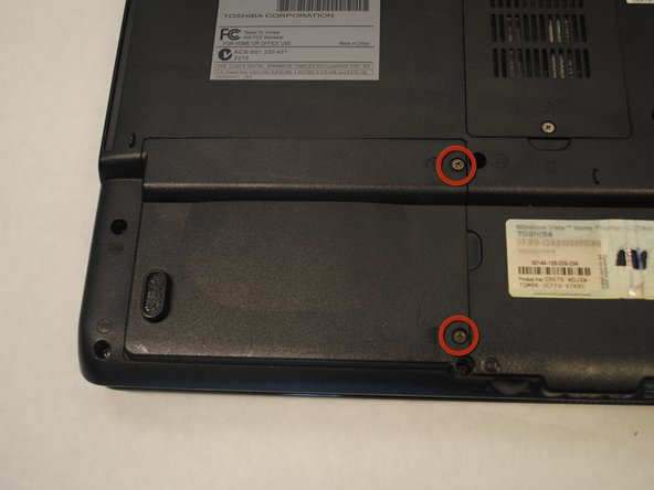 Locate the hard drive cover on the bottom, left-hand corner of your laptop.